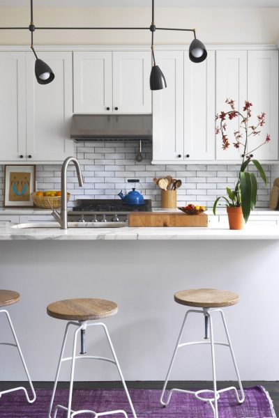 A visually expanding style that is all white and vibrant too. You won't ever feel like yawning in this kitchen for sure.