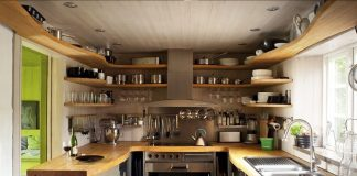 Swedish kitchen with wood shelves to keep all the cheese and the wine you love right in front of you.