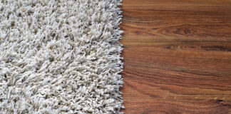 White shaggy carpet and brown wooden floor