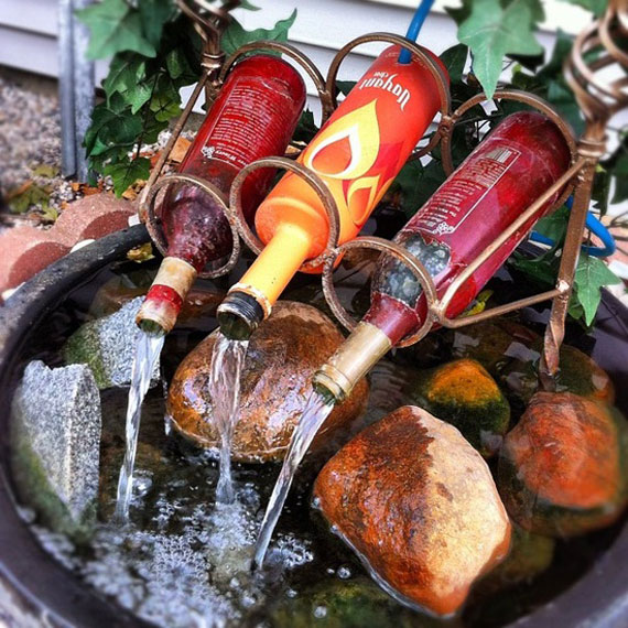 Used wine bottles sprinkling water on the gaden