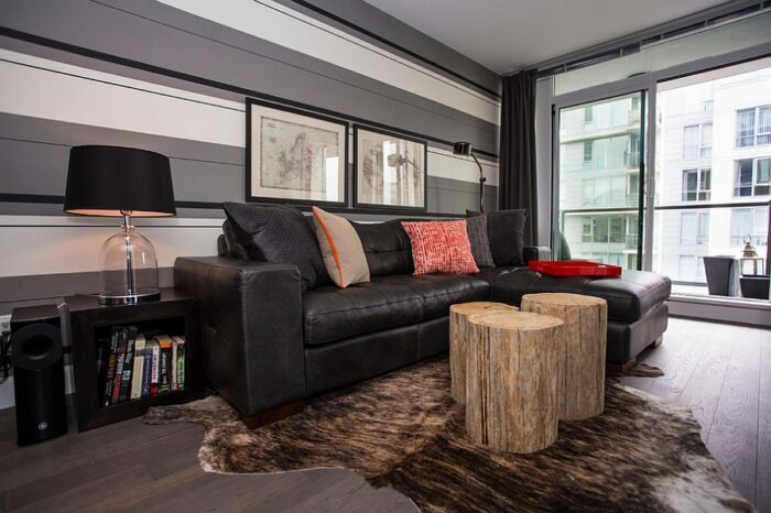 Custom made tree trunk coffee tables add rustic charm to the room
