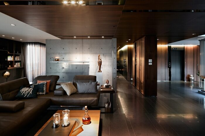 Deep, dark living room with cool textural contrast